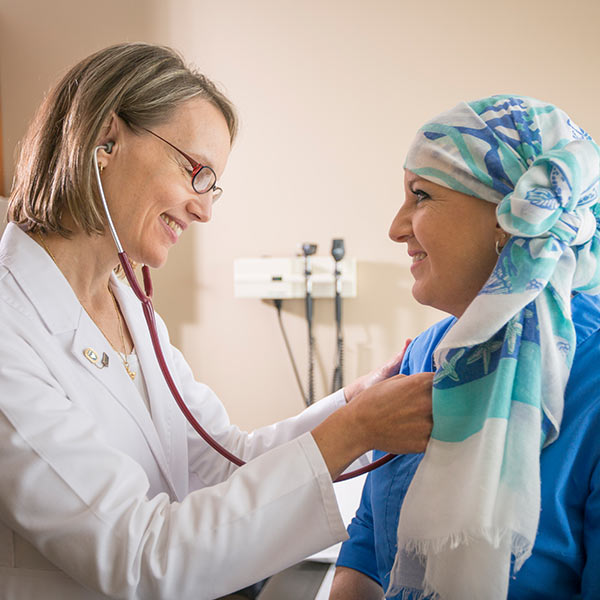 Medical person helping a patient