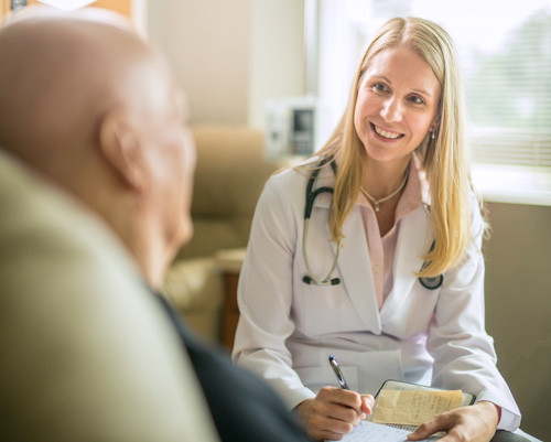 Medical person speaking with patient.